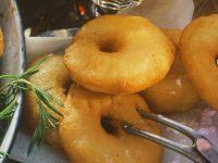Apfelkücherl mit Puderzucker Rezept