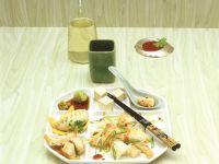 Asiafondue mit Fisch und Geflügel Rezept