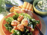 Blattsalat mit Kartoffeln im Speckmantel Rezept