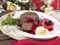 Braten vom Wildschwein mit Kartoffelpüree und Rotwein-Birne Rezept