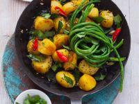 Bratkartoffeln mit Schlangenbohnen Rezept