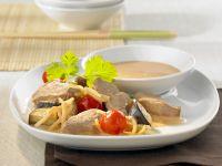 Entenbrustfilet mit Bambussprossen, Tomaten und Kokossoße Rezept