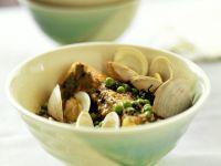 Fisch mit Gemüsesauce und Muscheln Rezept