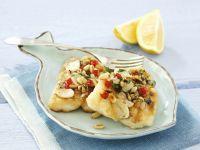 Fischfilet mit Pinienkernhaube Rezept