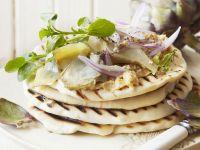 Fladenbrot mit Hummus und eingelegten Artischocken Rezept