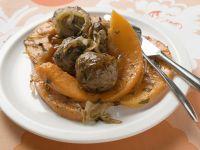 Fleischbällchen mit Kürbisspalten Rezept