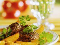 Frikadellen mit Kartoffelspalten Rezept