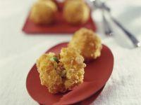 Frittierte Reisbällchen mit Füllung auf italienische Art Rezept