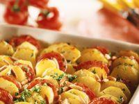 Gebackene Kartoffeln mit Tomaten Rezept