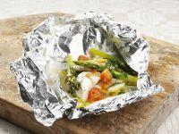 Gebackener Fisch mit Tomaten und Spargel Rezept