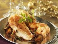 Gebratene Hähnchenbrust mit Pfifferlingen und Garnelen Rezept