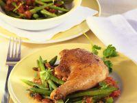 Gebratene Hähnchenkeulen mit Bohnengemüse Rezept
