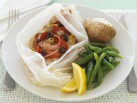 Gedämpftes Fischfilet mit Gemüse Rezept