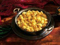 Geflügel in Currysoße auf indische Art (Chicken Korma)