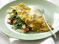 Gefülltes Omelett mit Tomaten, Pilzen und Schafskäse Rezept