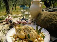 Geschmortes Kräuter-Hähnchen mit Schalotten und Knoblauch Rezept