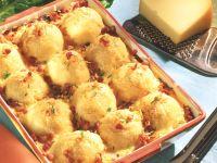 Gratinierte Kartoffelklöße auf Blattspinat Rezept