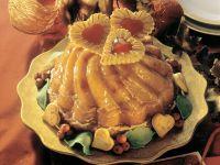 Gugelhupf mit Trockenfrüchten und Zuckerglasur Rezept