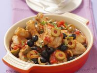 Hühnerkeulen in mediterraner Tomaten-Oliven-Sauce Rezept