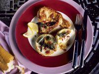 In Salbei-Chili-Butter gebratenens Kotelett mit Artischocken Rezept