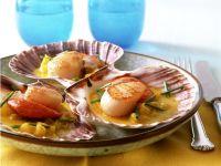 Jakobsmuscheln mit Currybutter und Ananas Rezept