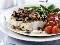 Kabeljau mit Oliven-Tomaten-Haube Rezept