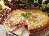 Käsekuchen mit Kirschen und Stachelbeeren Rezept