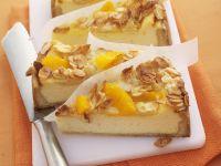 Käsekuchen mit Orangen und Mandelblättchen Rezept
