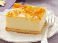 Käsekuchen mit Pfirsich-Topping Rezept