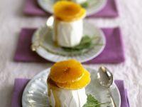 Kardamom-Eis mit Honigsauce und Mandarinenscheiben Rezept