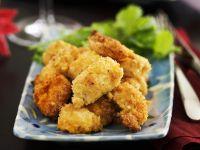 Karibische Hähnchen-Nuggets in Kokospanade