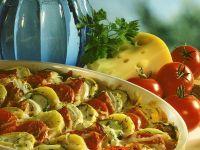 Kartoffel-Zucchini-Gratin mit Tomaten und Speck Rezept
