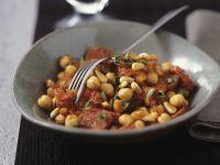 Kichererbsen-Tomaten-Gemüse mit Pinienkernen Rezept
