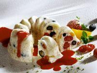 Kleiner Milchreiskuchen mit Erdbeersoße Rezept