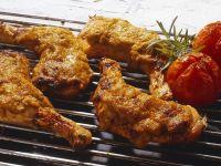 Knusprige Hähnchenkeulen vom Grill Rezept