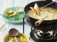 Kokosfondue mit Curry-Mandel-Soße und Ananassoße