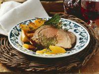 Kräuterlammbraten mit Orangen mit Rosmarinkartoffeln Rezept