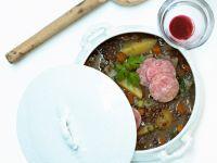 Linseneintopf mit Kartoffeln und Würstchen Rezept