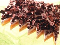 Mandarinen-Sahne-Kuchen mit Mandel-Schoko-Splittern Rezept