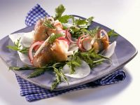 Matjesfilets auf Rettich-Rucola-Salat