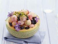 Melone gefüllt mit Borretsch und Pistazien Rezept