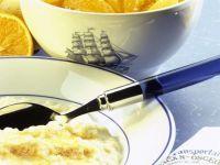 Milchreis mit Zucker & Schale mit frischen Orangenspalten Rezept