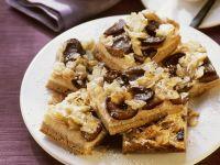 Milchreis-Zwetschgen-Kuchen mit Mandeln Rezept