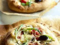 Mini-Pizzen mit Rucola Rezept