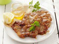 Mit Honig marinierte Schweinenackensteaks Rezept