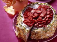 Panna-Cotta-Torte mit Erdbeeren und Mandelrand Rezept