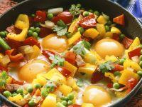 Paprikapfanne mit Erbsen und Ei Rezept