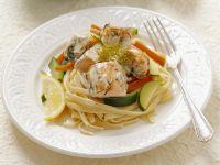 Pasta mit Lachsfilet, Karotten und Zucchini Rezept
