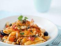Pasta mit Tomatensugo und Garnelenschwänzen Rezept