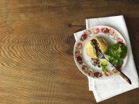 Pikanter Krapfen mit Hirschschinken und Pilzen Rezept
